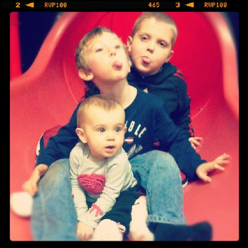 Carson,his Memphis BFF, Ayden and Darby playing at Chick-Fil-A.