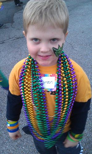Mardi Gras at the RMH! Carson collected all these necklaces at the parade.