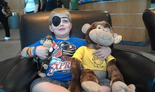 Carson and his monkey. Monkey will be filling in at Carson's school back home while he is gone.