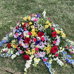 Close up of the flowers placed on her grave.