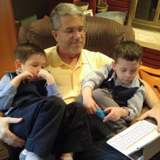 Larry with the grandchildren, Benjamin and Logan.