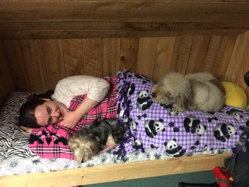 All 3 of us (me, Ezra, and Bella) squished up together in my bed in our cabin.