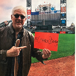 Mike Krukow showing his strength.