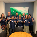 Members of LMU's Student Affairs team, including Senior Vice President Dr. Lane Bove, show off their strength.