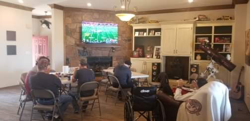 Watching the game with buddies as the open house began