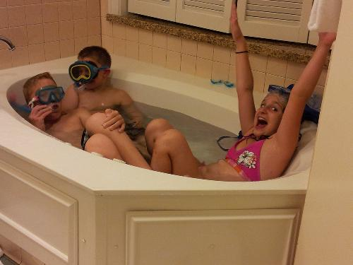 Our first night at the Disney Resort (Villa). 3 of 4 grand-kids settling down for bedtime relaxing in the spa tub . . . until they put on the masks and snorkels! A joyous noise!