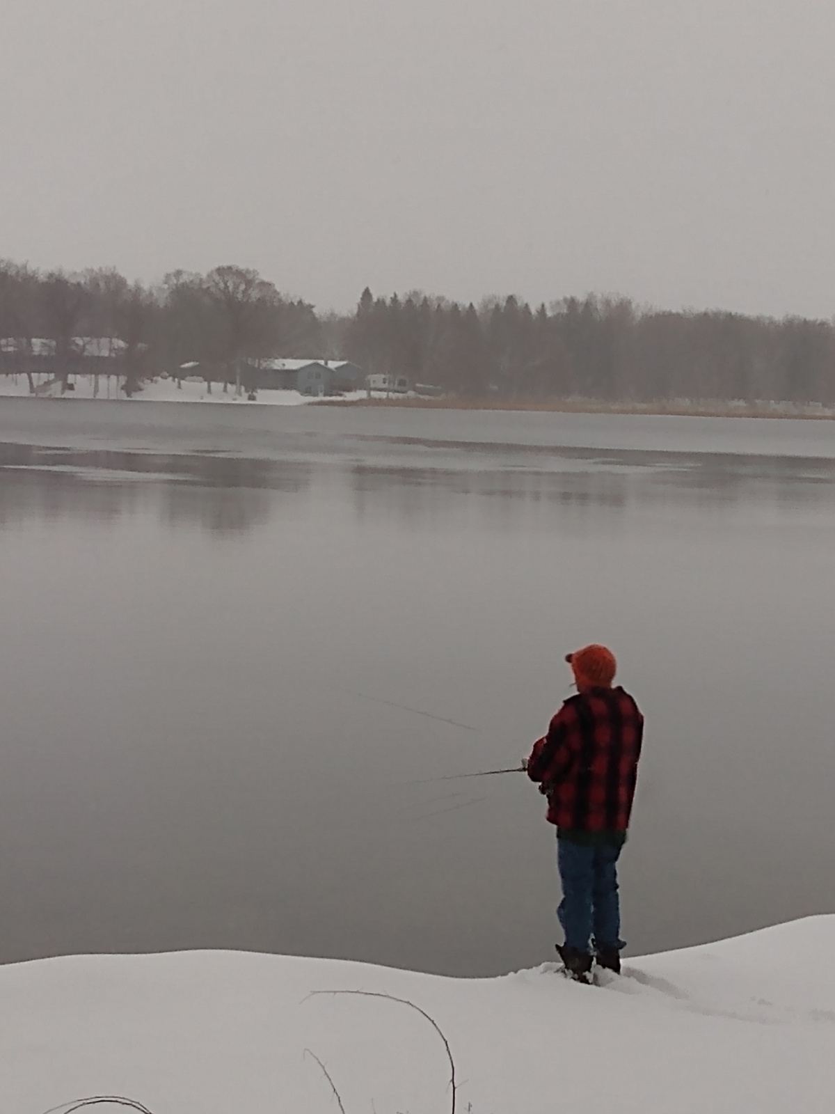 Keith attempting to fish on Sunday, lake open.
