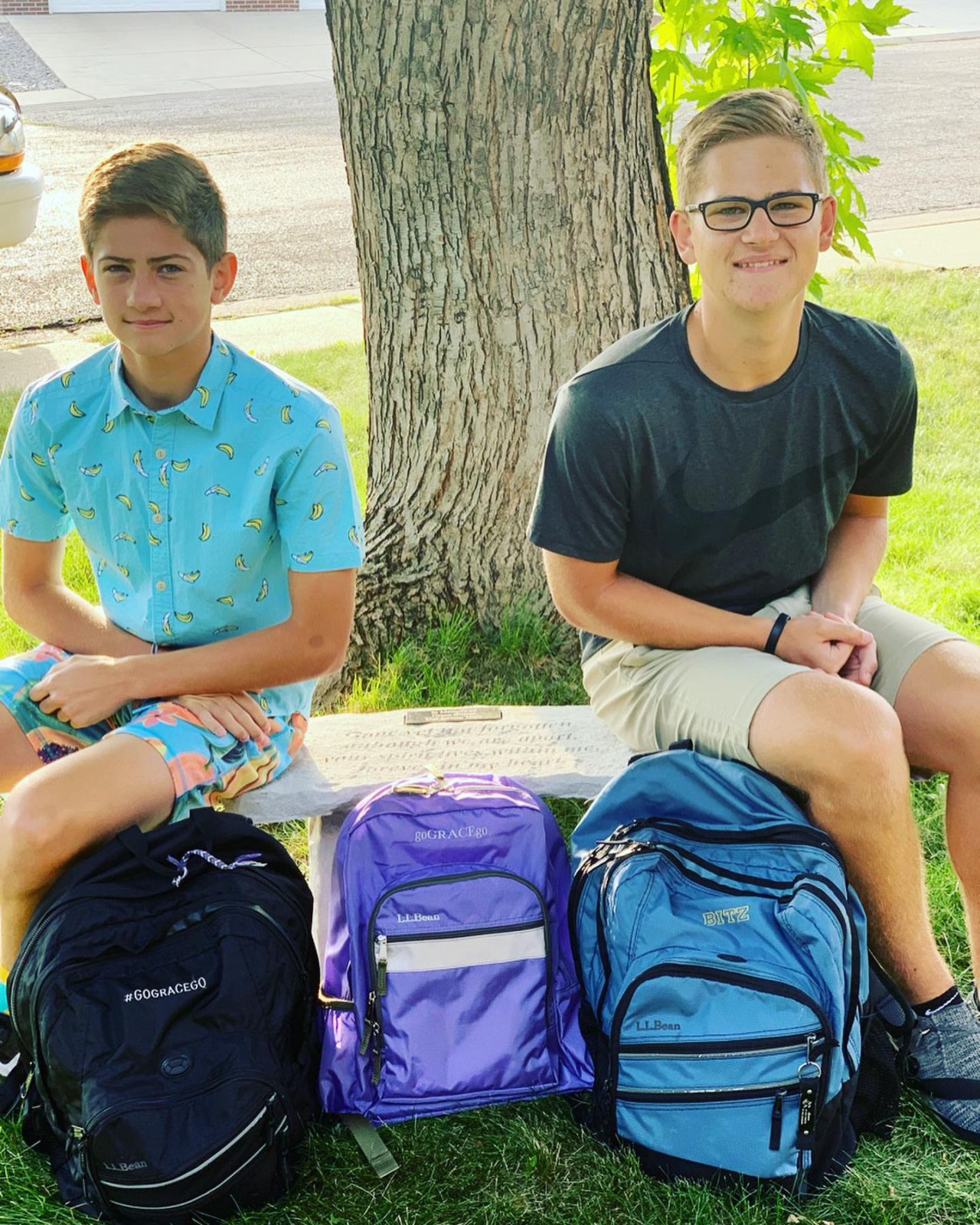 Grant (10th) and Owen (8th)  {{Grace 2nd}} on their first day of school.