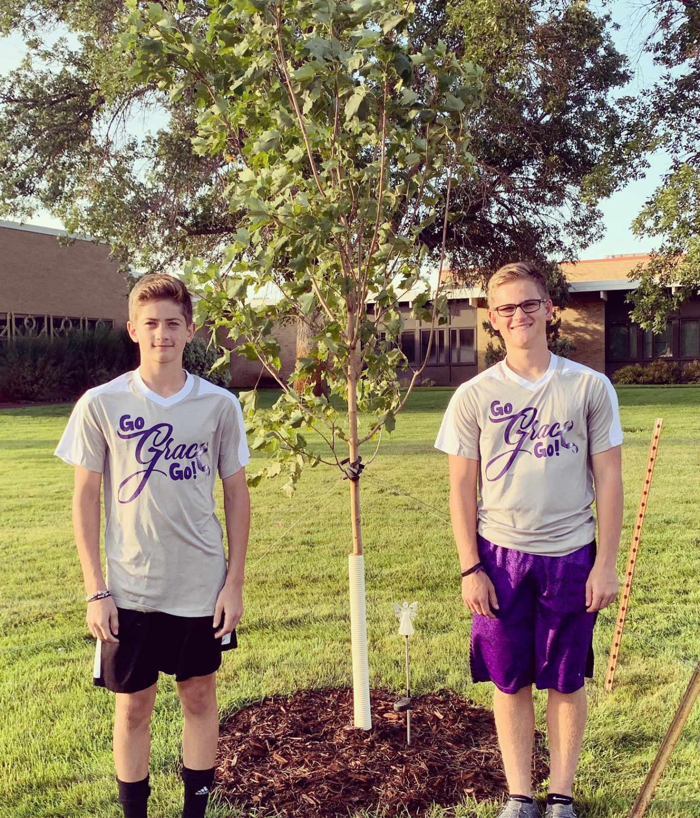 Owen and Grant by Grace's Memorial tree at Lincoln Elementary School
