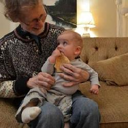 Grandson Arlo's first piece of lefse, shared with his GrandDan.