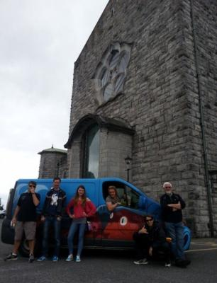 "Carter, Joe, Project Pops, and our Irish connections, with the purple octopus kite surfing van, at the cathedral in Galway, during our previous Centre College football trip, 2014. Carter actually played in the game, vs ""The Dublin Rebels,"" racking up eight tackles in one quarter of play!!!"