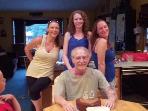 Steve with his 3 girls on his 59th birthday - 4th of July.