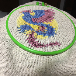 I am a Phoenix. I rise from the ashes. This rendition of a phoenix , I stitched in the winter of 2017, while I was on disability leave due to crippling osteoarthritis in my left knee. After I showed it in the Lodi Agricultural Fair and the Columbia County Fair, I gave it to the physical therapists at UW Health at the American Center, to remind them of what they do every day -- help people rise up.