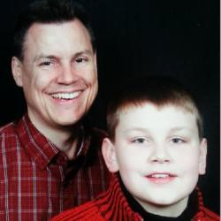 Mike and his son Joshua.  Joshua is bigger now -- everyday he grows another inch!!