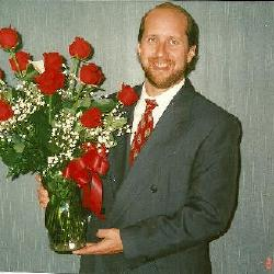 "Kimberly  was voted, by her peers as ""Employee of the Year"" for TECO in Kissimmee in 1999.  Here's Joey and the flowers he gave me!"