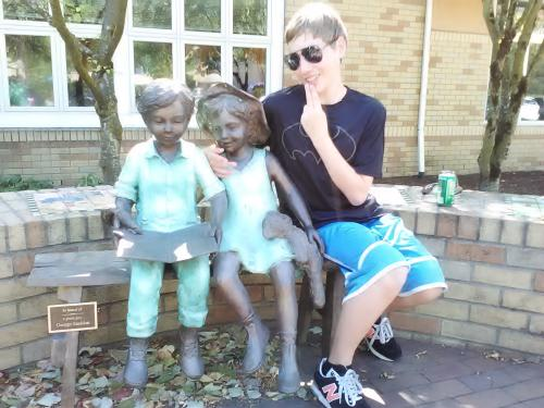 Dylan after his sinus surgery in September 2015. Posing with some statues outside the Ronald McDonald House where we were staying.
