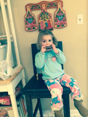 Annabelle playing the harmonica for Opa