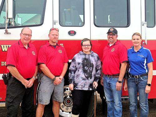 Gabrielle with the Windom Fire & Ambulance . L-R Dan Ortman, Fire Chief, Ben Derickson, Gabbie, Jordan Bussa, Kristen Porath. Jordan and Kristin are the EMT's that rode in the back of the ambulance with Gabrielle from the accident scene to the Windom Hospital.