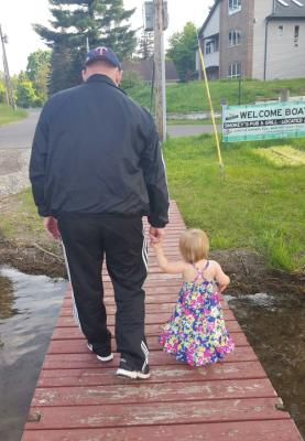 G'Pa and Brielle after a boat ride.Warms my heart.ps I asurre you,she does have legs:)