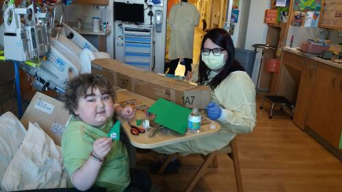 Keeping busy in his hospital room.  Here Samuel is building a really big boat with the art therapist.
