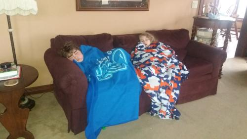 These two stayed up late having a slumber party in Samuel's room.  They both fell back asleep on the couch this morning shortly after getting up.