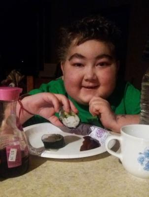 Samuel eating one of his favorite foods, sushi.