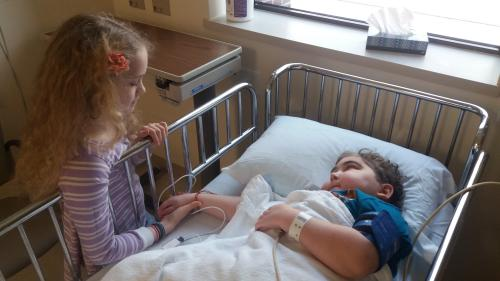 As soon as Samuel woke up after his bone marrow test, he asked for Rachel so he could hold her hand.  Oh, such sweetness!