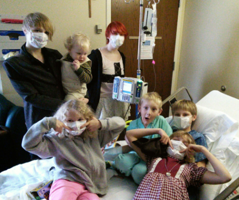All the kids coming to see Samuel and say goodbye before he transferred to Riley Hospital the next morning.  He was neutropenic (his white blood cell counts were low) so everyone had to wear a mask to come into his room.  That didn't stop these siblings from laughing and having fun despite the circumstances.