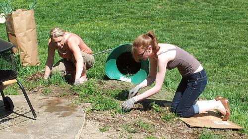 Valerie & Amanda helping by doing some yard beautification.