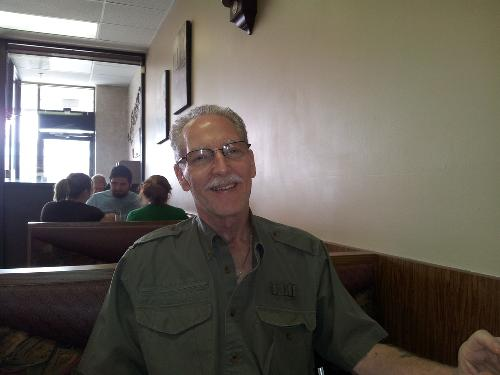 Eating breakfast at Dimitri's shortly after getting out of hospital in early May, 2013.