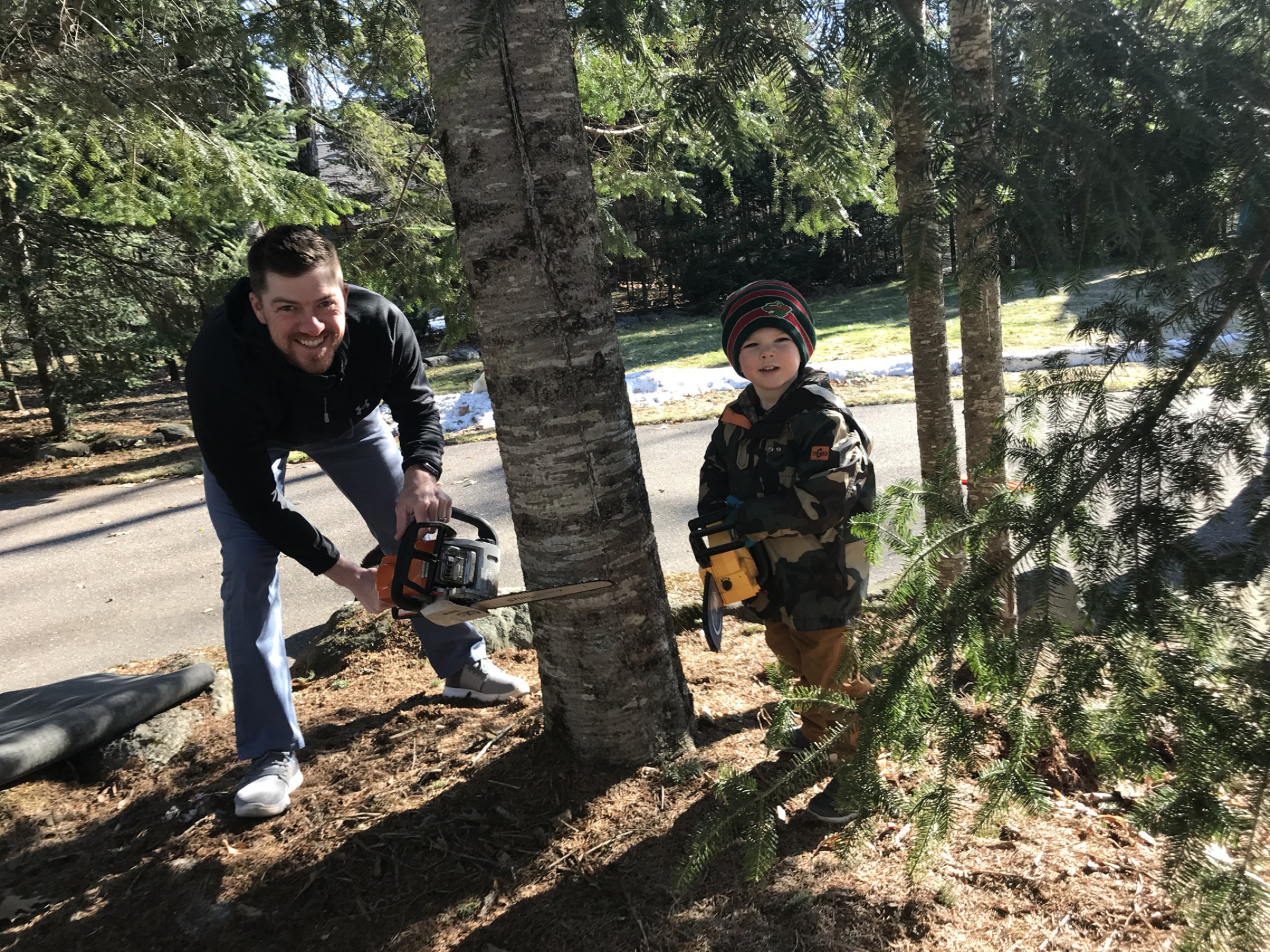 Son-in-love Mike and grandson Colden help trim up trees and haul the down trees from our tough winer of ice and snow!