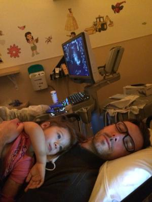Kidney ultra sound. Gets to lay on Daddy and watch Lilo and Stitch.