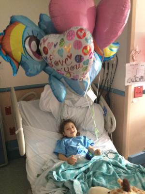 Her amazing pediatrician sent some balloons and a ballerina! Thank you Dr. Papez!