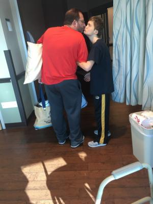 Peyton and Mike getting ready to leave his hospital room and walk out of there. Praise God!