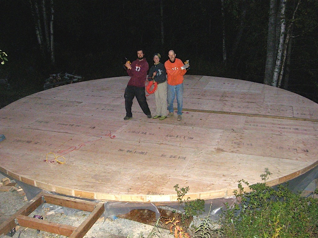 Ben with his mom and dad on a finished yurt floor out in Chugiak.