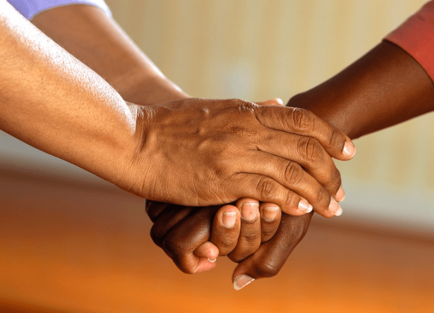 caregivers holding each others hands