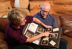 JoAnn and Darrin showing pictures of their daughter Brighid
