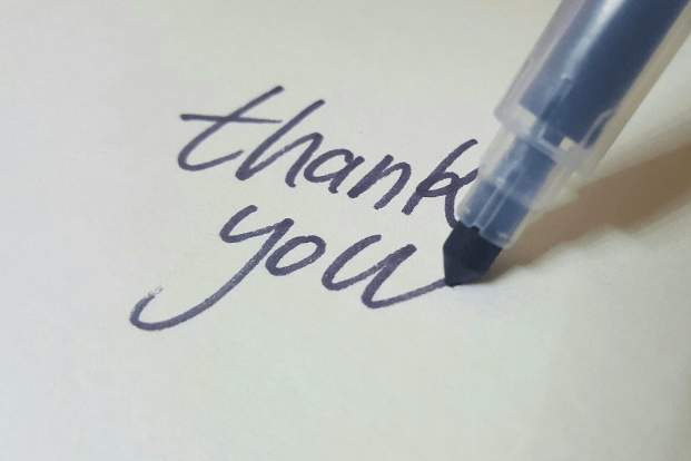 pen writing thank you for caregiver