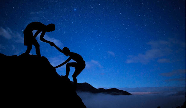 shadows helping each other climb up a mountain at twilight