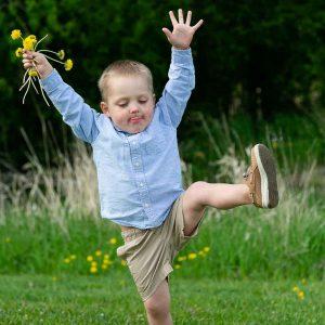 <i>4-year-old Jack picking flowers</i>