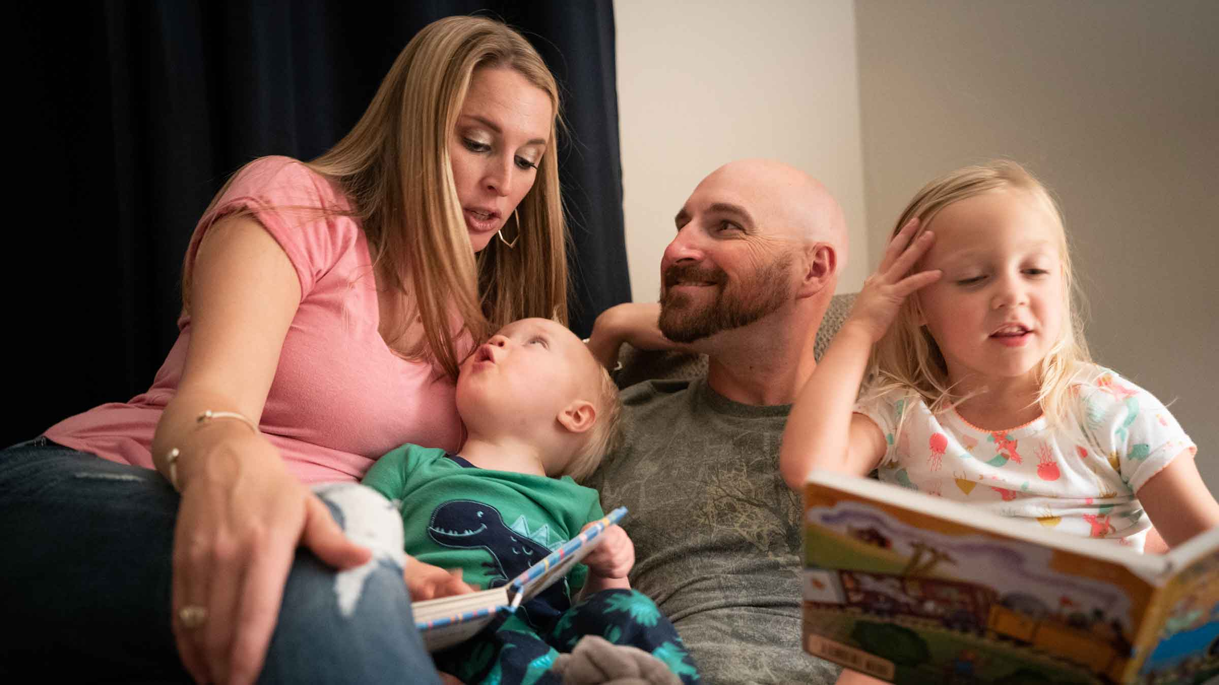 The Hammond family reads bedtime stories.