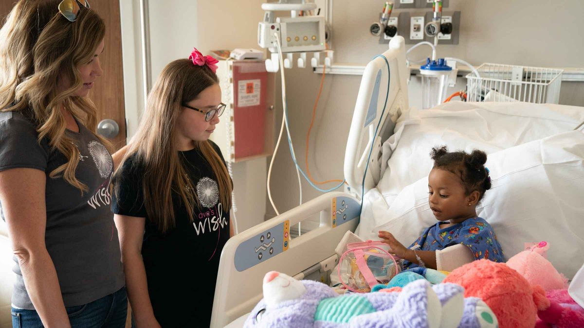 Ava Lopez at hospital speaking to patient